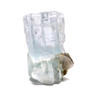 A transparent gemmy blue aquamarine crystal with mica inclusions against a white background
