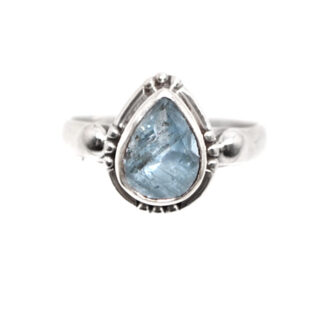 A sterling silver ring featuring a faceted teardrop aquamarine gemstone against a white background