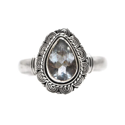 A decorative sterling silver ring featuring a teardrop faceted aquamarine gemstone against a white background