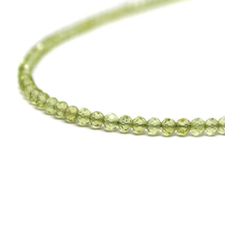 A peridot microbead necklace against a white background