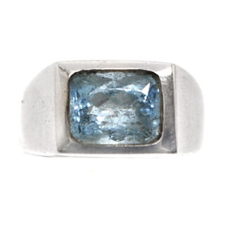 A simple sterling silver ring featuring a rectangular faceted aquamarine gemstone against a white background