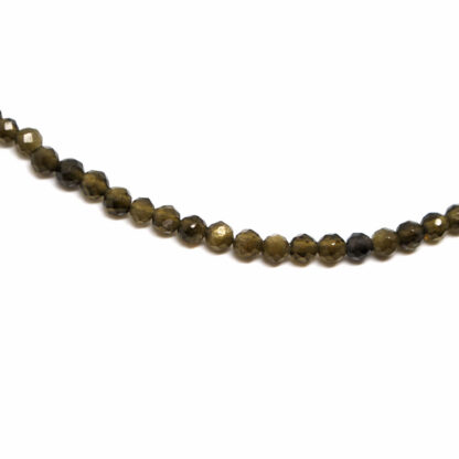 A gold sheen obsidian microbead bracelet against a white background