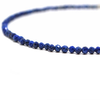 A lapis lazuli microbead bracelet against a white background