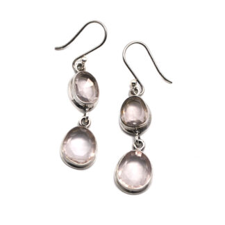A pair of sterling silver earrings with two faceted rose quartz gemstones linked together on each earring against a white background