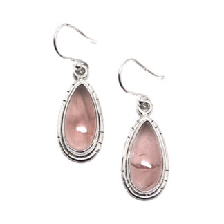A pair of sterling silver earrings featuring teardrop rose quartz cabochons with decorative notches around the setting against a white background