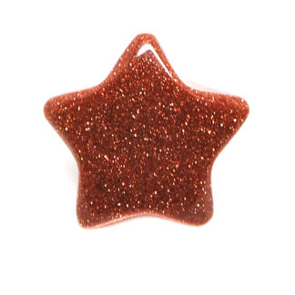A goldstone star carving against a white background