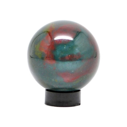 A small bloodstone sphere with dark green and red tones on a black acrylic ring stand against a white background