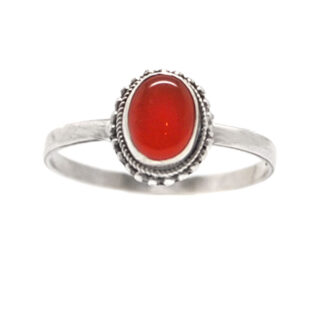 A sterling silver ring featuring a deep orange oval shaped carnelian stone against a white background