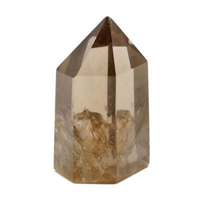 A translucent polished smokey quartz crystal point against a white background