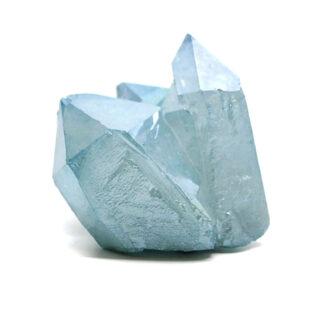 An aqua aura quartz crystal against a white background