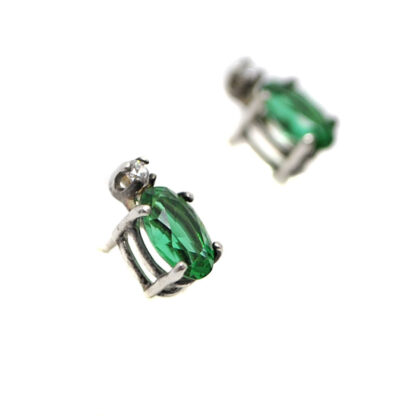 Emerald Obsidianite Oval Sterling Silver Stud Earrings with Cubic Zirconium accents against a white background