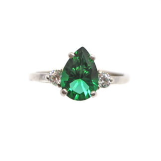 Emerald Obsidianite Pear Cut Sterling Silver Ring with Cubic Zirconium accents against a white background