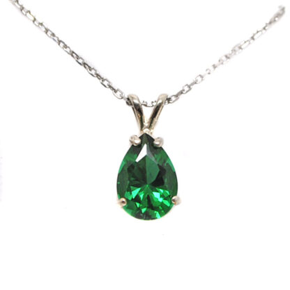 Emerald Obsidianite Pear Cut Sterling Silver Pendant against a white background