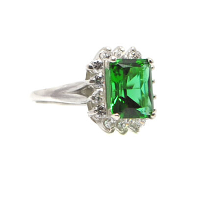 Emerald Obsidianite emerald cut Sterling Silver Ring with Cubic Zirconium accents surrounding the gemstone against a white background