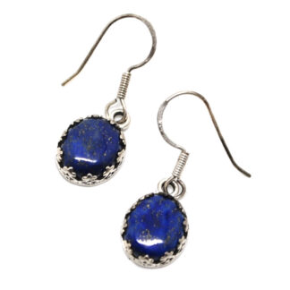 A pair of round lapis lazuli sterling silver earrings with crown-like bezels against a white background