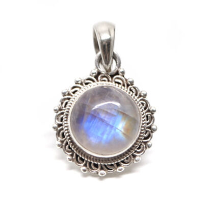 A round rainbow moonstone sterling silver pendant with an ornate bezel against a white background