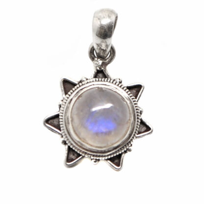 A round rainbow moonstone sterling silver pendant with a star bezel against a white background