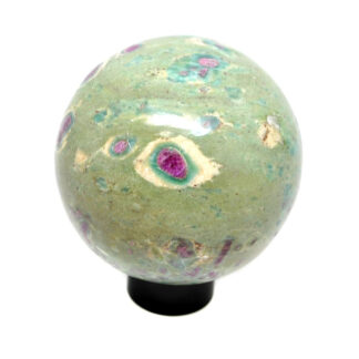 A ruby in fuchsite sphere on a black ring stand against a white background
