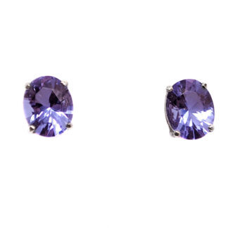 A pair of oval twilight obsidianite gemstone sterling silver stud earrings against a white background