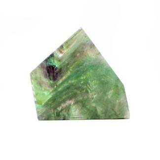 A cut and polished rainbow fluorite slab with bright green and purple tones against a white background