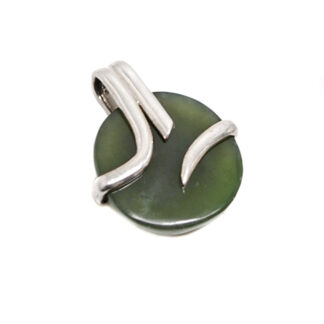 A round dark green jade cabochon set into a wrapped style sterling silver pendant against a white background