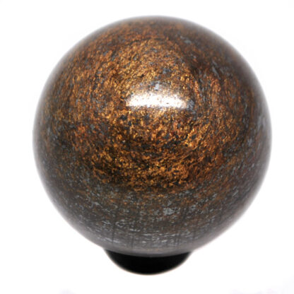 A polished bronzite sphere on a black ring stand against a white background