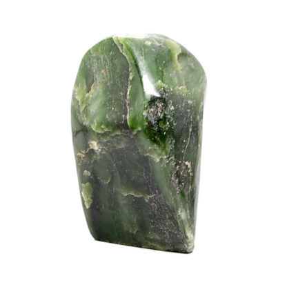 A polished free form nephrite jade specimen against a white background
